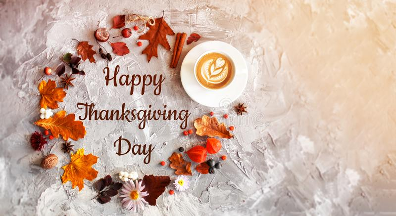 Happy Thanksgiving Day background. Table decorated with autumn leaf, coffee, flowers. Beautiful Holiday Autumn festival concept scene Fall, Harvest. Flat lay royalty free stock images