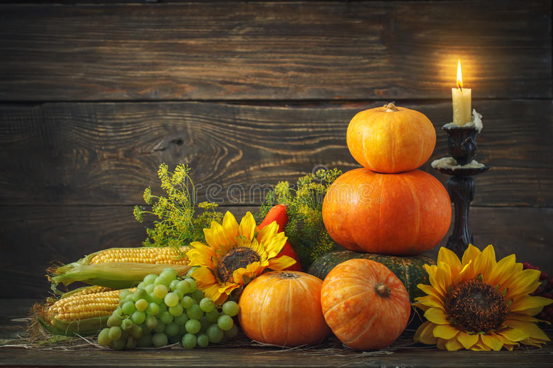 Happy Thanksgiving Day background, wooden table, decorated with vegetables, fruits and autumn leaves. Autumn background. stock image