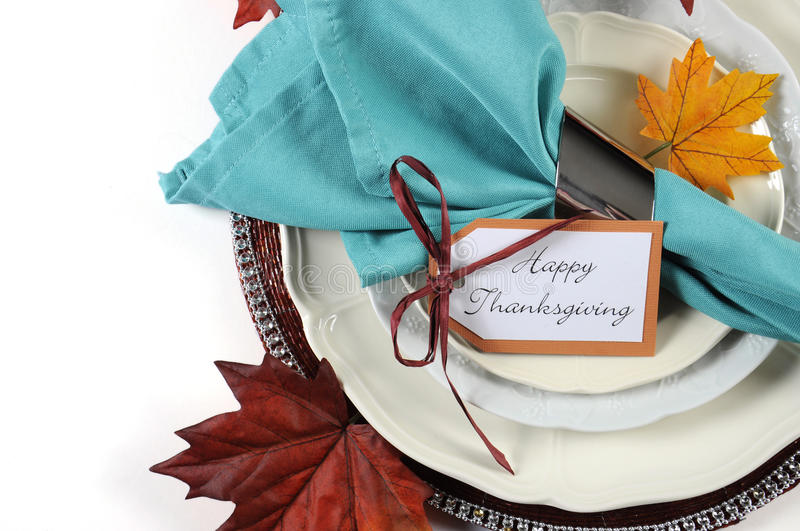 Happy Thanksgiving dining table place setting in Autumn brown and aqua color theme. With copy space royalty free stock photo