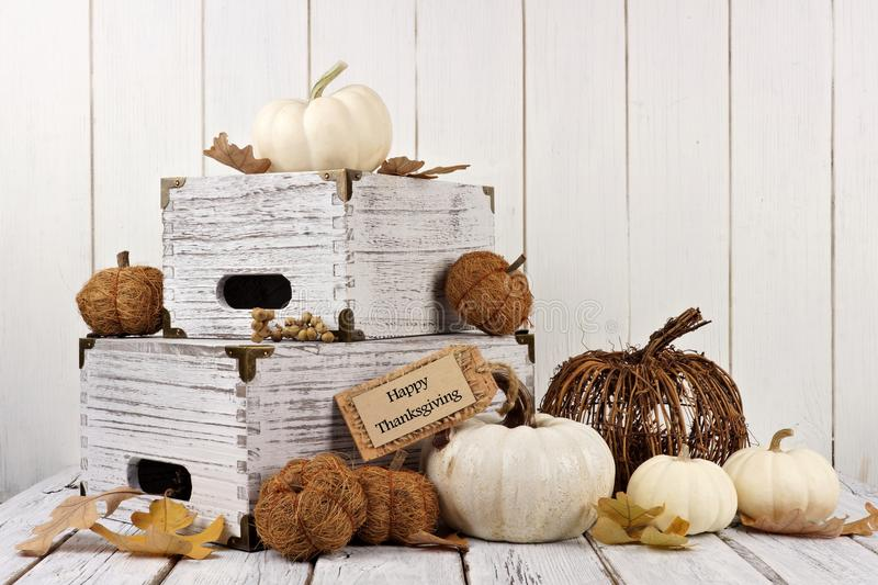 Happy Thanksgiving tag with decor against white wood. Happy Thanksgiving tag with shabby chic autumn decor against a white wood background stock photos