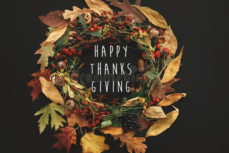 Happy Thanksgiving text on autumn wreath flat lay. Fall leaves c royalty free stock photography