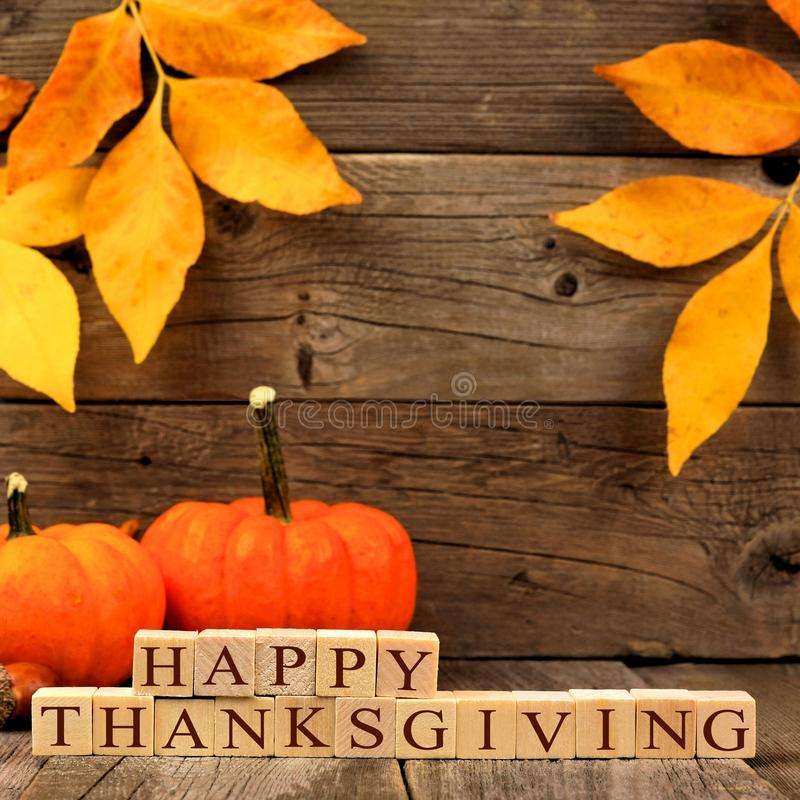 Download Happy Thanksgiving Wooden Blocks With Wood Background Leaves And Pumpkins Stock Image