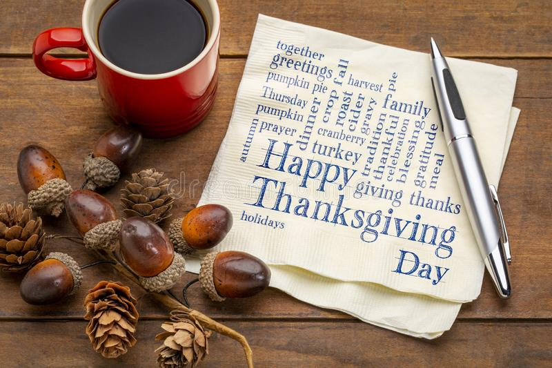 Happy Thanksgiving word cloud on blackboard. Happy Thanksgiving word cloud - handwriting on a napkin with a cup of coffee and fall decoration royalty free stock photography
