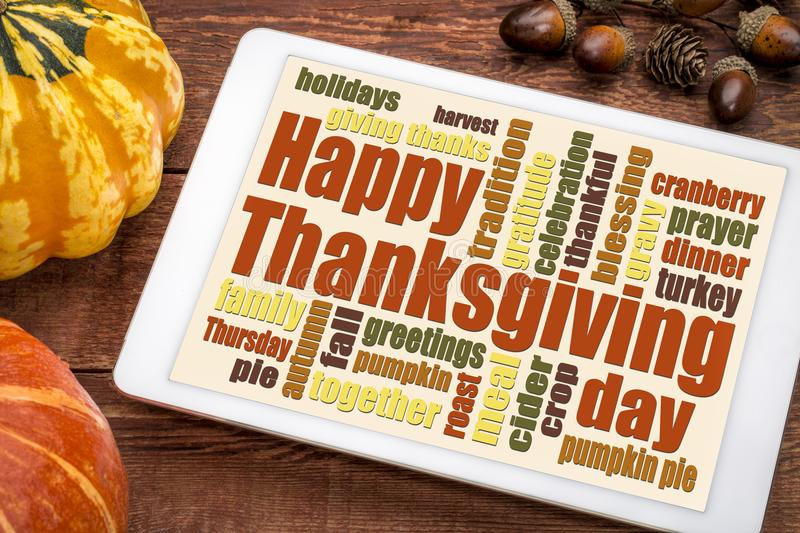 Happy Thanksgiving word cloud on a tablet stock photos