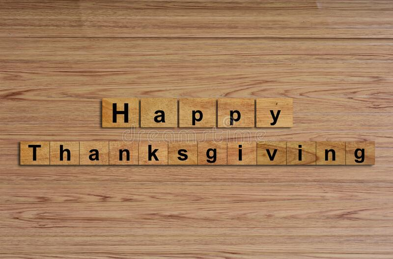 Happy Thanksgiving written on wood cubes. Message text on wooden table for backdrop design stock photos