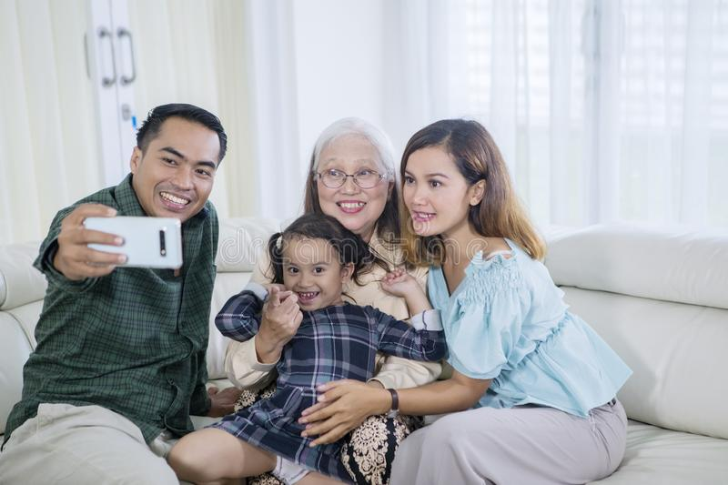 Happy three generation family takes selfie at home royalty free stock photos