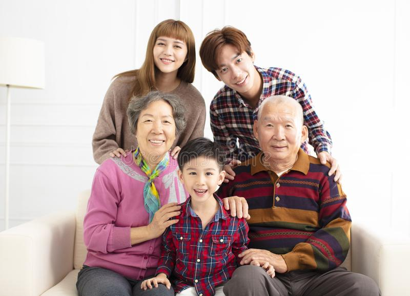 Three generations asian family on sofa stock photos