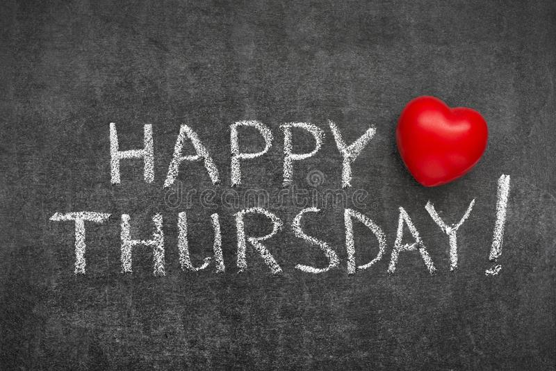 Happy Thursday. Phrase handwritten on blackboard with heart symbol instead of O royalty free stock images