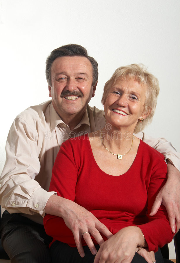 Happy times. Happy old couple at home with copyspace royalty free stock image