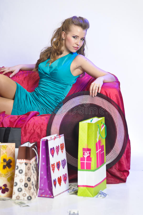 Happy and tired woman resting after shopping stock image
