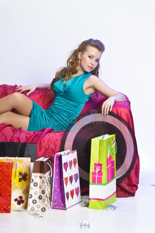 Happy and tired woman resting after shopping stock photo