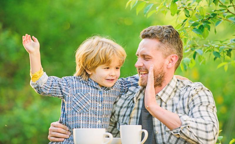 Happy to be a family. organic and natural food. they love eating together. Weekend breakfast. healthy food. Family day. Bonding. small boy child with dad stock photo