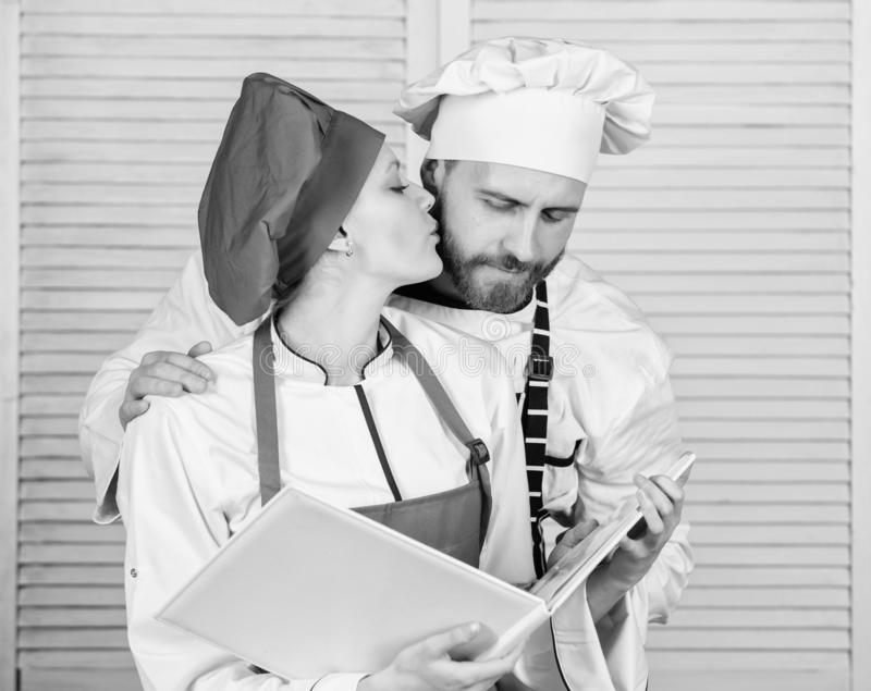 Happy to be in love. couple in love with perfect food. man and woman chef in restaurant. Menu planning. culinary cuisine stock photography