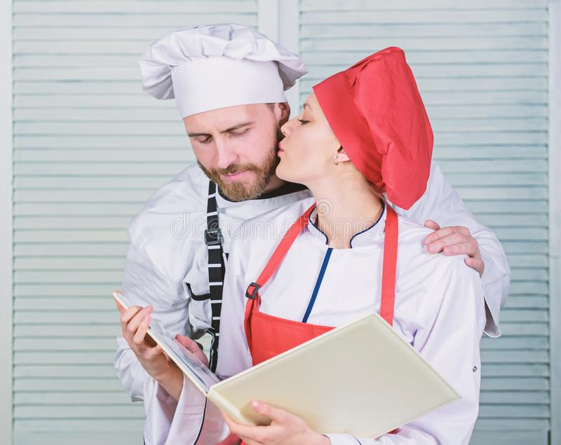 Happy to be in love. couple in love with perfect food. man and woman chef in restaurant. Menu planning. culinary cuisine stock photos
