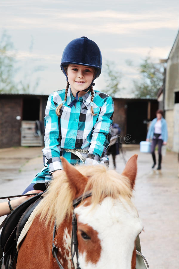Download Happy to be riding stock photo. Image of yard, girl, riding - 23614782