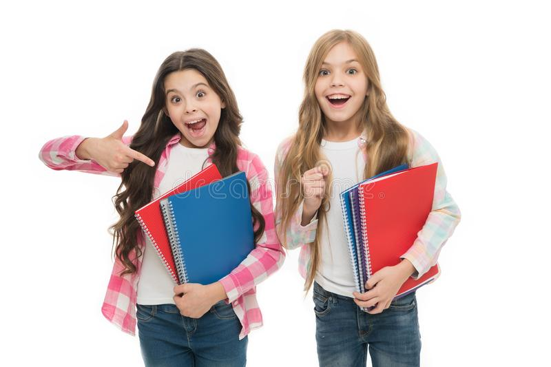 Happy to be students. School supplies concept. We love study. School stationery. Pupils carrying big textbooks to school royalty free stock photo