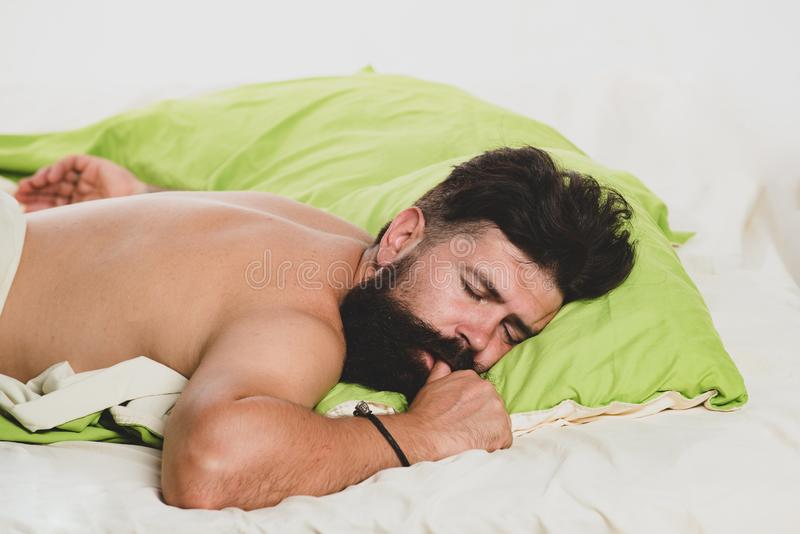 Happy to Sleep. Man lying in bed and sleeping. Guy lying in bed try to relax and fall sleep. Happy to Sleep. Happy to Sleep. Man lying in bed and sleeping. Guy royalty free stock photo