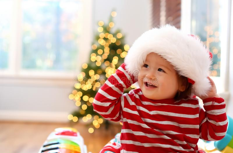 Happy toddler boy playing on Christmas stock photography