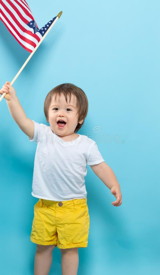 Happy toddler boy waving American flags royalty free stock images