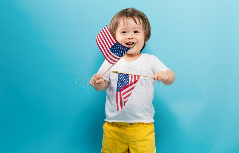 Happy toddler boy waving American flags royalty free stock photos