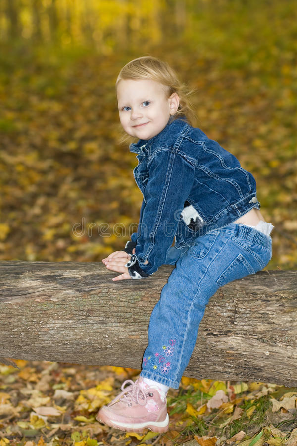 Happy toddler in the forest. stock images