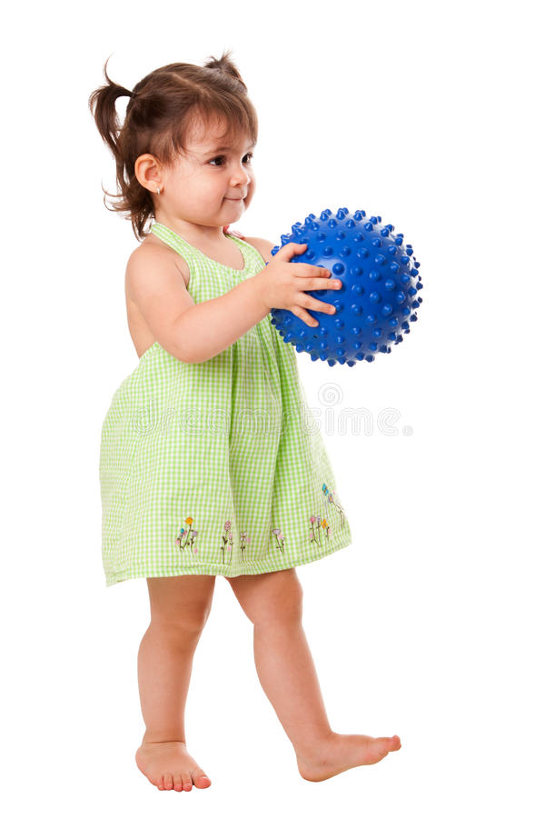 Happy toddler girl with ball stock photo