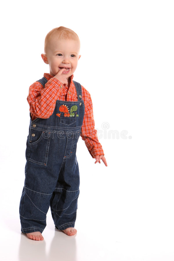 Happy toddler in overalls royalty free stock photo