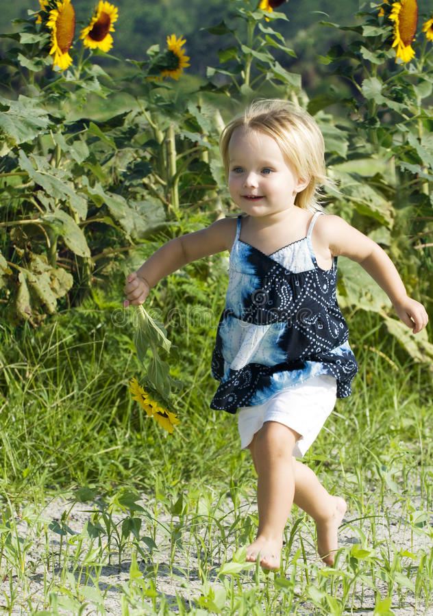 Download Happy Toddler Running In Field Stock Photo - Image: 9808776