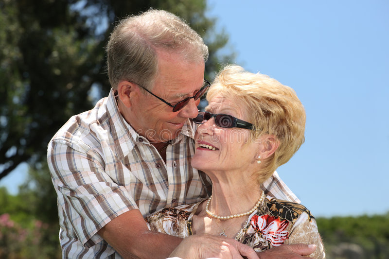 So happy together. Romantic senior couple relaxing outdoors royalty free stock photos