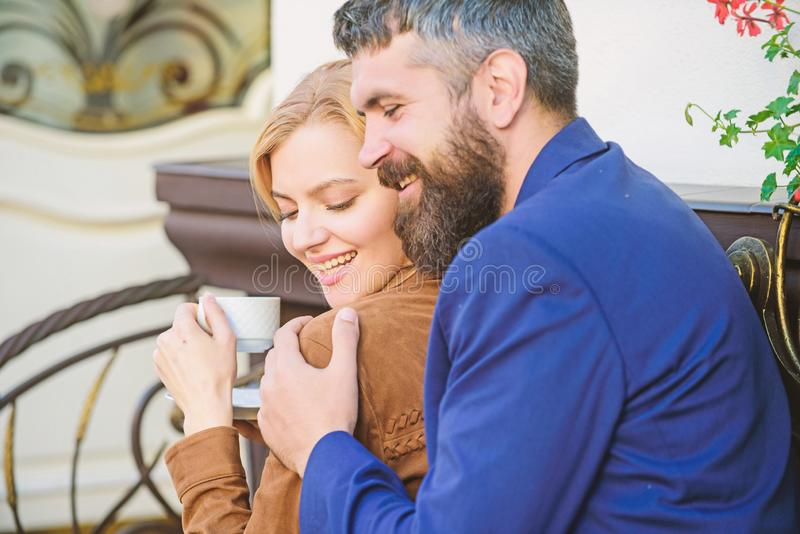 Happy together. Couple cuddling cafe terrace. Couple in love sit hug cafe terrace enjoy coffee. Pleasant family weekend. Explore cafe and public places royalty free stock image