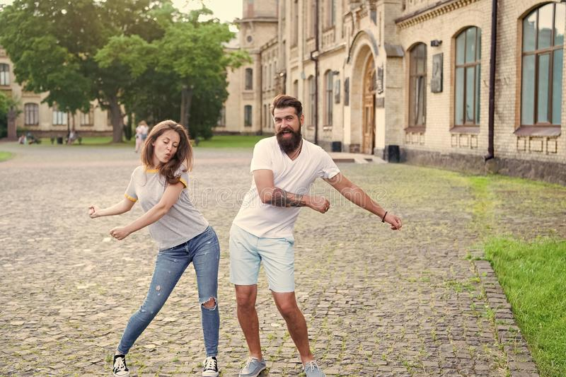 Happy together. Couple in love walking having fun. Couple relaxing enjoying each other. Man bearded hipster and pretty royalty free stock images