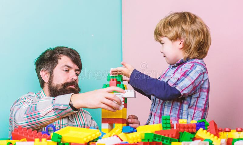 Always happy together. happy family leisure. father and son play game. child development. small boy with dad playing stock photography