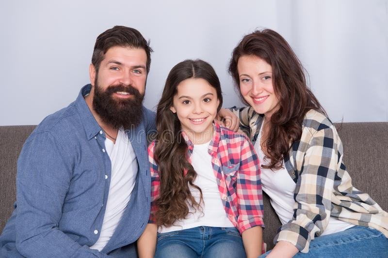 Always happy together. family weekend. mother and father love daughter. little girl with parents. trust and bonds. Bearded man and woman with child. happy royalty free stock image