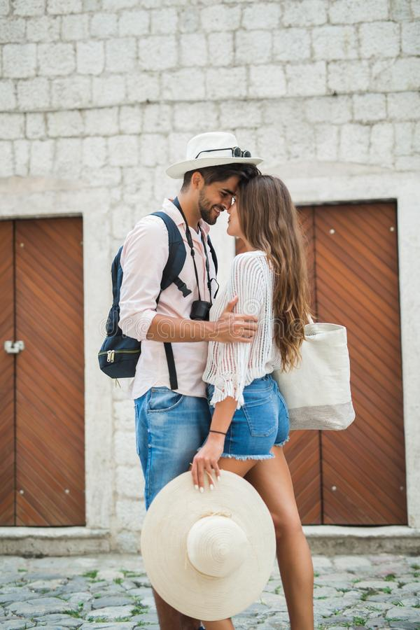 Happy tourist couple in love traveling stock image