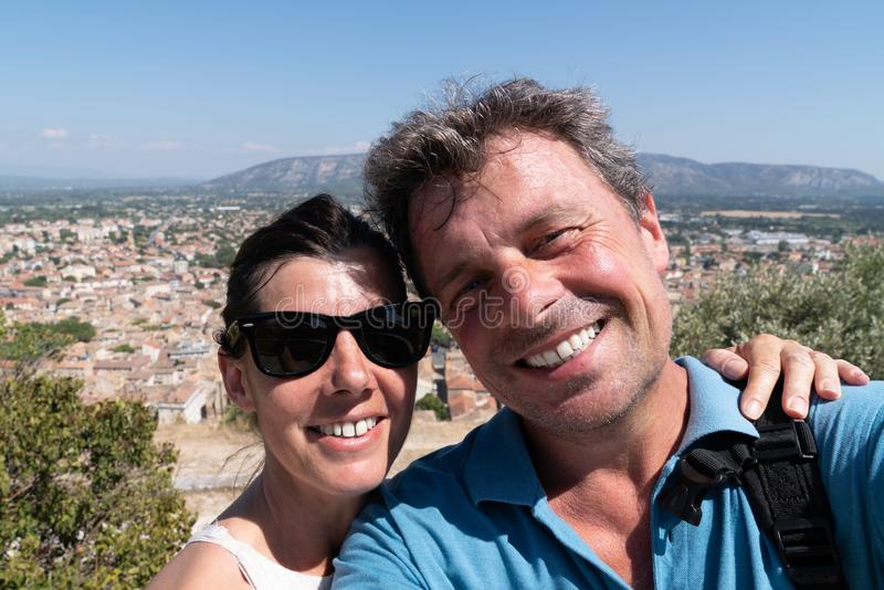Happy tourist couple make selfie in hill cavaillon city France royalty free stock image