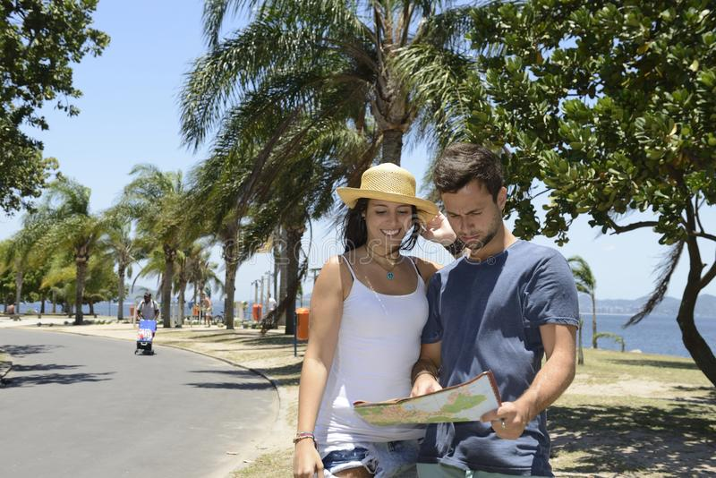 Happy tourist couple with map royalty free stock images