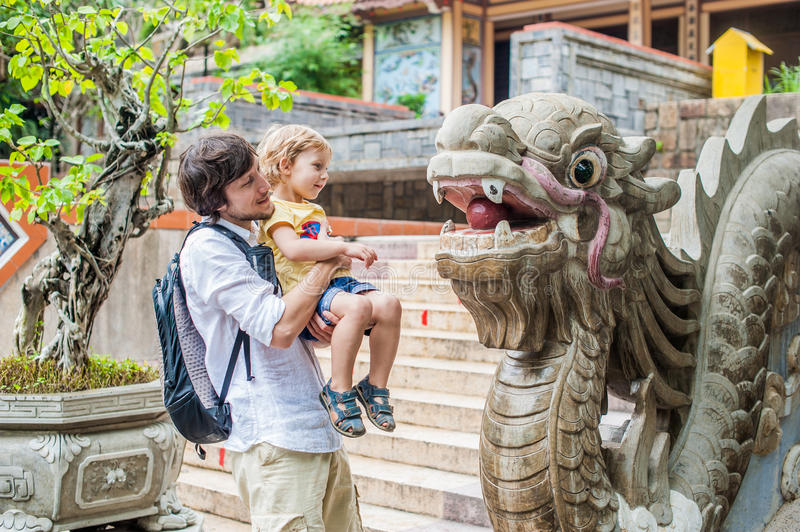 Happy tourists dad and son in LongSon Pagoda. Happy tourists dad and son in Long Son Pagoda. Travel to Asia concept. Traveling with a baby concept stock photography