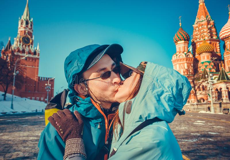 Happy tourists kissing on Red Square, Moscow royalty free stock image