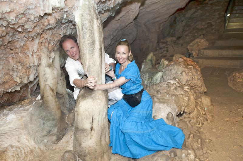 Happy tourists, man and woman in a Bellamar cave. Matanzas, Cuba royalty free stock image