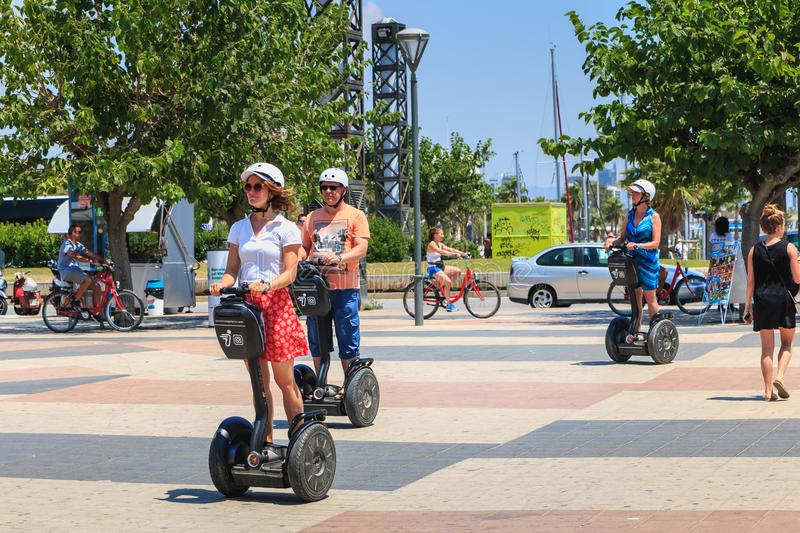 Happy tourists moves on the beach of Barcelona with segway stock photo