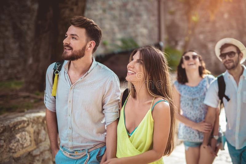 Happy tourists sightseeing in the city stock photo