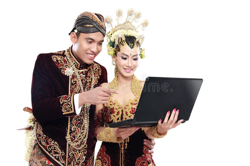 Download Happy Traditional Java Wedding Couple With Laptop Stock Images - Image: 30829894