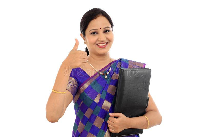 Happy traditional woman holding folder against white stock photos