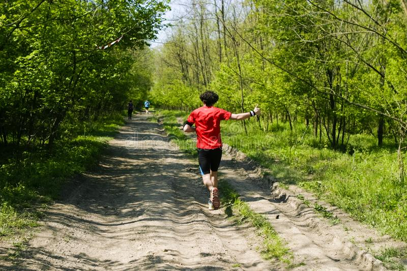 Happy trail runner waving on a trail stock photos