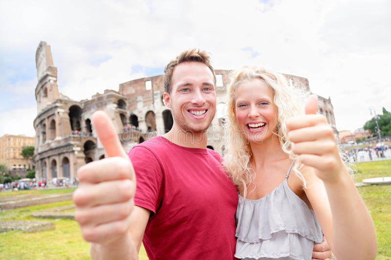 Happy travel couple in Rome by Coliseum in love stock photography