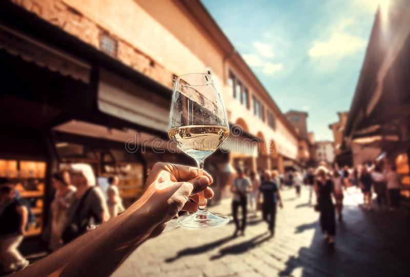 Happy travel with wine glass in narrow streets of Italy. Sunny evening in Europe stock photography