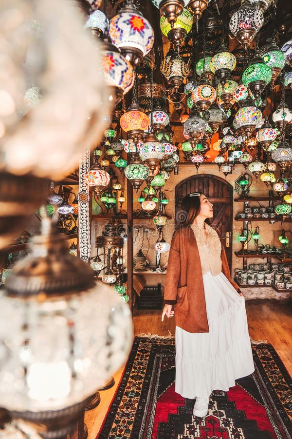 Happy travel woman choosing Amazing traditional handmade turkish lamps in Local souvenir shop ,Goreme. Cappadocia Turkey royalty free stock photos