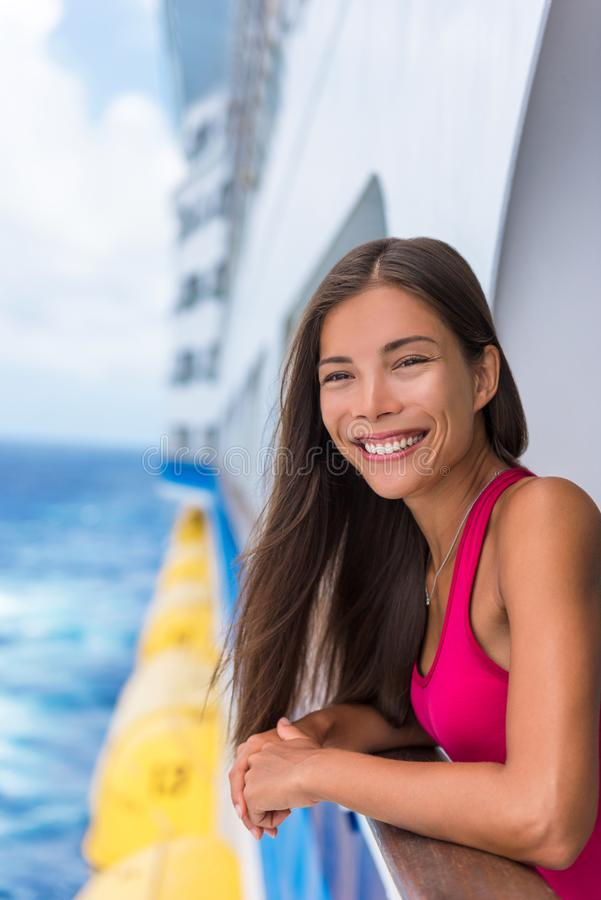 Happy travel woman on cruise vacation smiling at her Caribbean or Europe holidays ahead of her. Summer holiday. Asian girl royalty free stock image