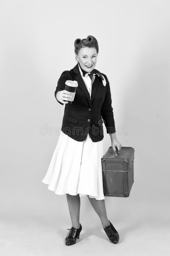 Happy travel woman with cup of coffee and suitcase. Brunette woman goes to trip stock images