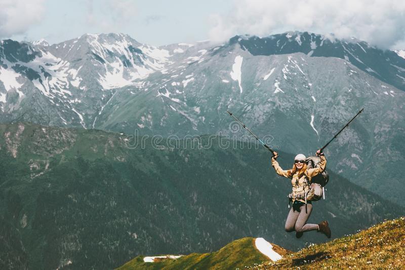 Happy travel Woman jumping up raised hands stock photography